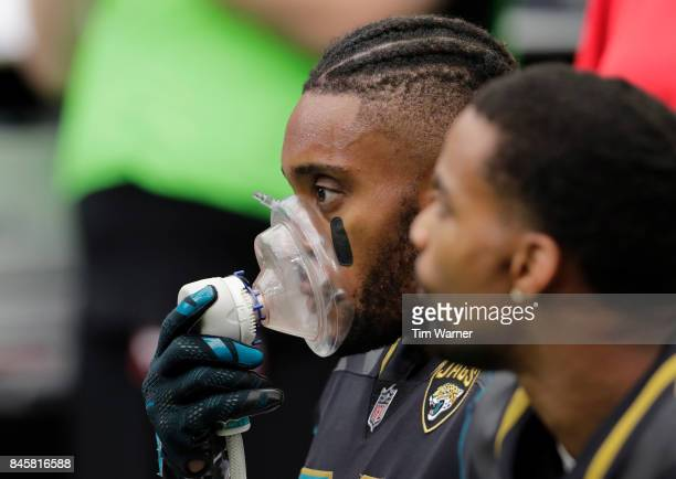 Aaron Colvin of the Jacksonville Jaguars rest with oxygen on the bench during the second half against the Houston Texans at NRG Stadium on September...