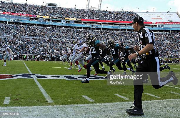 Aaron Colvin of the Jacksonville Jaguars runs a fumble back for a touchdown during the fourth quarter of the game against the New York Giants at...