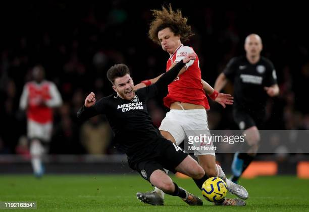 Aaron Connelly of Brighton is challenged by David Luiz of Arsenal during the Premier League match between Arsenal FC and Brighton Hove Albion at...