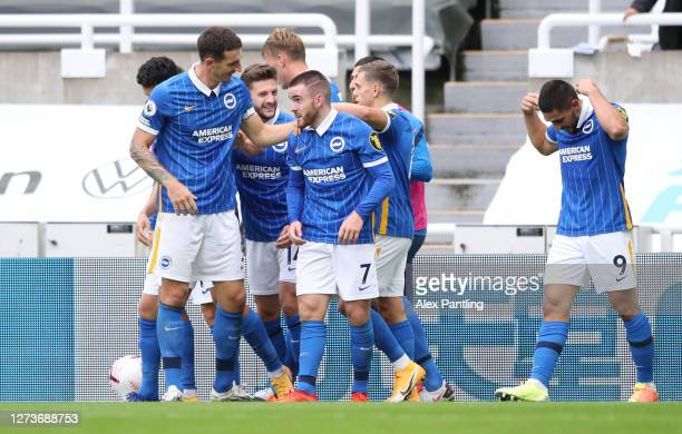 Aaron Connolly of Brighton and Hove Albion celebrates with teammates after scoring his team's third goal during the Premier League match between...