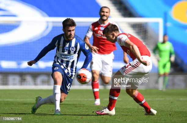 Aaron Connolly of Brighton and Hove Albion is challenged by Kieran Tierney of Arsenal during the Premier League match between Brighton Hove Albion...