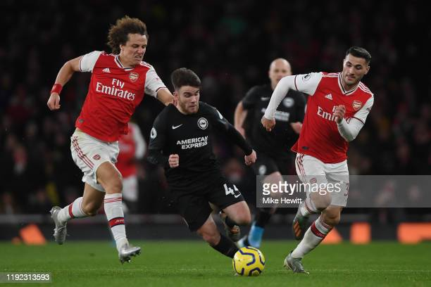 Aaron Connolly of Brighton Hove Albion ia fouled by David Luiz of Arsenal during the Premier League match between Arsenal FC and Brighton Hove Albion...