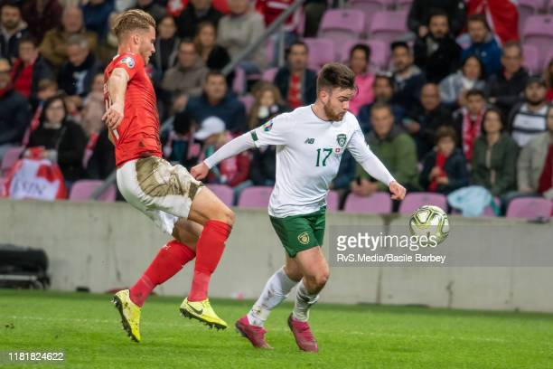 Aaron Connolly of Republic of Ireland battles for the ball with Nico Elvedi of Switzerland during the UEFA Euro 2020 qualifier between Switzerland...