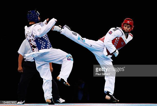 Aaron Cook of Great Britain in action against Gianluca D'Alessandrio of Italy during the Taekwondo preliminary round at the London Prepares LOCOG...