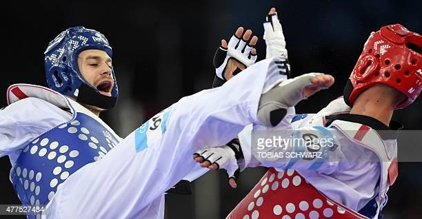 Aaron Cook of Moldavia competes against Arbes Jahiri of Kosovo during their Taekwondo men's 80kg preliminary fight at the 2015 European Games in Baku...