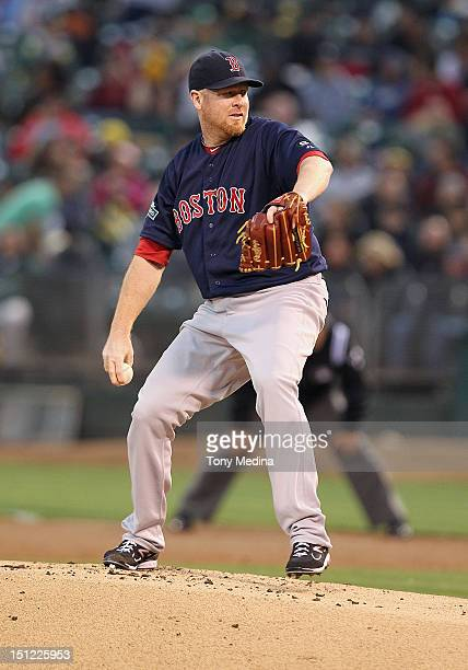 Aaron Cook of the Boston Red Sox pitches during a game against the Oakland Athletics at Oco Coliseum on August 31 2012 in Oakland California