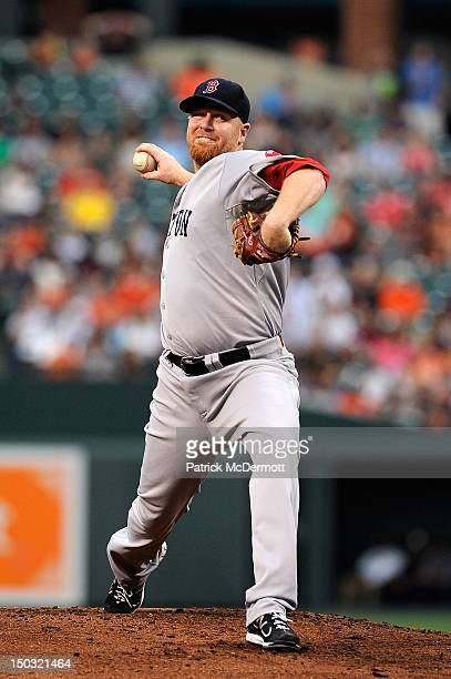 Aaron Cook of the Boston Red Sox throws a pitch against the Baltimore Orioles during a game at Oriole Park at Camden Yards on August 15 2012 in...