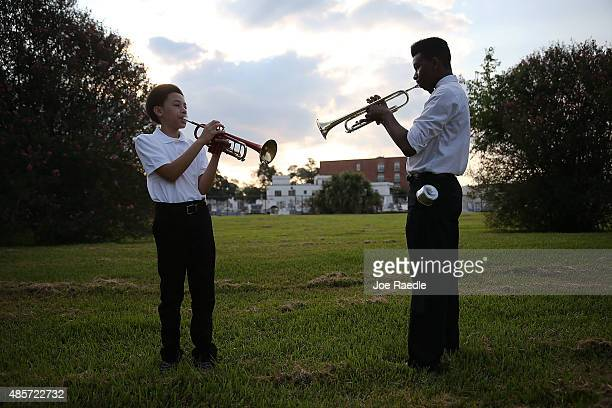 Aaron Covin and Cameron Clark practice before performing in a jazz funeral procession during a 10th anniversary of Hurricane Katrina event at the New...