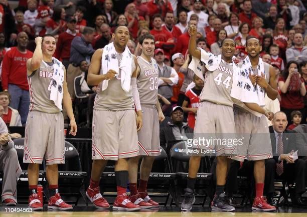Aaron Craft, Jared Sullinger, Jon Diebler, William Buford and David Lighty of the Ohio State Buckeyes look on from the bench late in the second half...