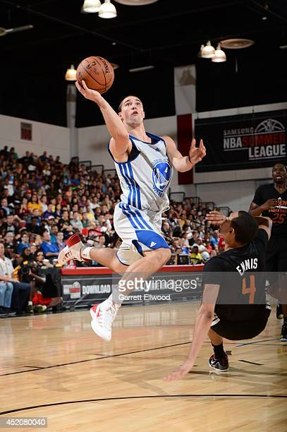 Aaron Craft of the Golden State Warriors goes up for a shot against the Phoenix Suns at the Samsung NBA Summer League 2014 on July 12 2014 at the Cox...