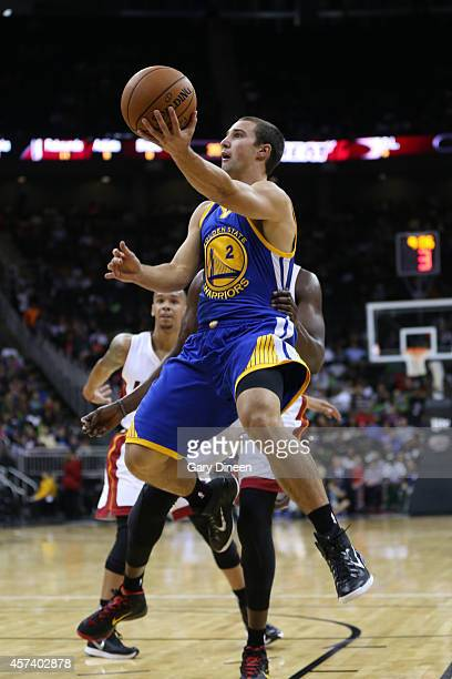 Aaron Craft of the Golden State Warriors takes a layup against the Miami Heat during a game on October 17 2014 at Sprint Center in Kansas City...