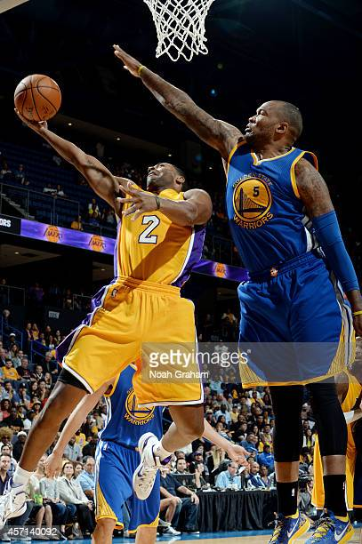 Aaron Craft of the Los Angeles Lakers goes to the basket against Marreese Speights of the Golden State Warriors on October 12 2014 at Citizens...