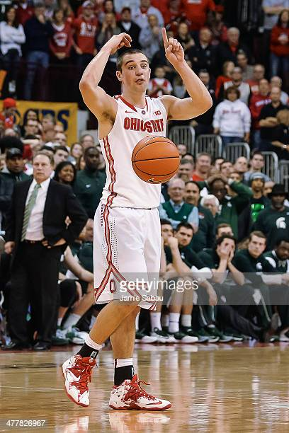 Aaron Craft of the Ohio State Buckeyes controls the ball against the Michigan State Spartans on March 9 2014 at Value City Arena in Columbus Ohio