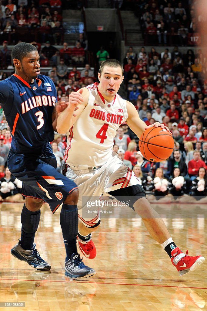Aaron Craft #4 of the Ohio State Buckeyes controls the ball and drives around Brandon Paul #3 of the Illinois Fighting Illini in the second half on March 10, 2013 at Value City Arena in Columbus, Ohio. Ohio State defeated Illinois 68-55.