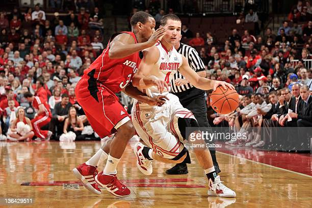 Aaron Craft of the Ohio State Buckeyes dribbles around Brandon Richardson of the Nebraska Cornhuskers on January 3 2012 at Value City Arena in...