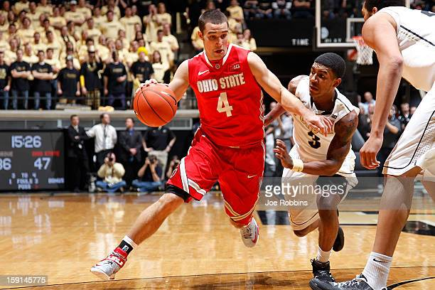 Aaron Craft of the Ohio State Buckeyes dribbles up the floor against Ronnie Johnson of the Purdue Boilermakers during the game at Mackey Arena on...