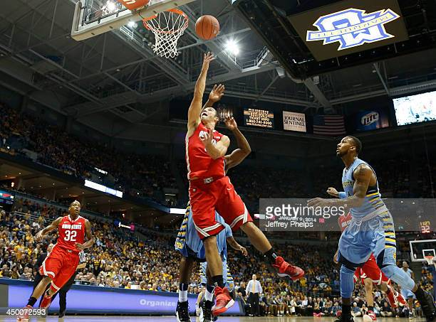 Aaron Craft of the Ohio State Buckeyes drives against Todd Mayo of the Marquette Golden Eagles during a basketball game at BMO Harris Bradley Center...