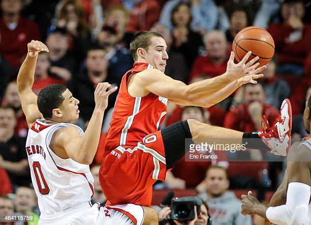 Aaron Craft of the Ohio State Buckeyes grabs a rebound over Tai Webster of the Nebraska Cornhuskers during a game at Pinnacle Bank Arena on January...