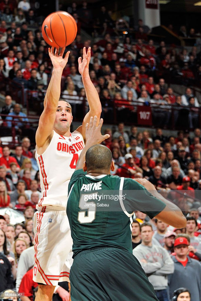 Aaron Craft #4 of the Ohio State Buckeyes shoots over Adreian Payne #5 of the Michigan State Spartans in the second half on February 24, 2013 at Value City Arena in Columbus, Ohio. Craft led all scorers with 21 points in Ohio State's 68-60 win over Michigan State.