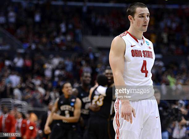 Aaron Craft of the Ohio State Buckeyes walks off the court after losing to the Wichita State Shockers 7066 during the West Regional Final of the 2013...