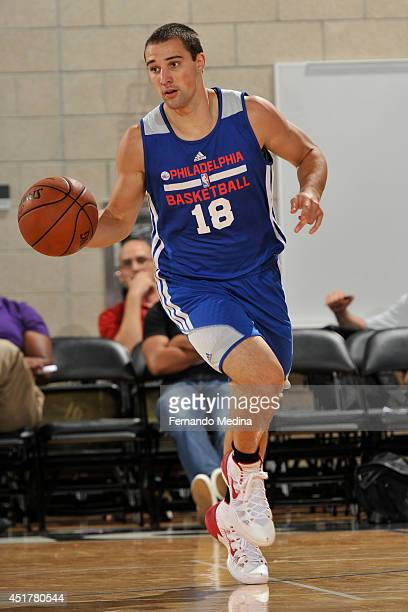 Aaron Craft of the Philadelphia 76ers handles the ball against the Oklahoma City Thunder during the Samsung NBA Summer League 2014 on July 6 2014 at...