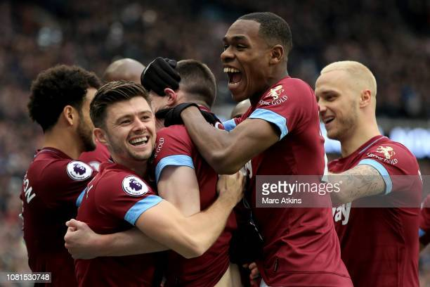Aaron Cresswell and Issa Diop of West Ham United celebrate with Declan Rice during the Premier League match between West Ham United and Arsenal FC at...