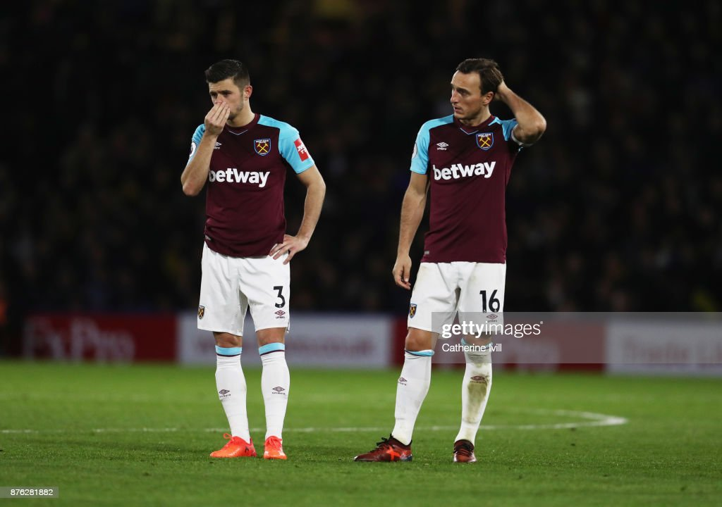 Aaron Cresswell and Mark Noble of West Ham United look dejected during the Premier League match between Watford and West Ham United at Vicarage Road on November 19, 2017 in Watford, England.