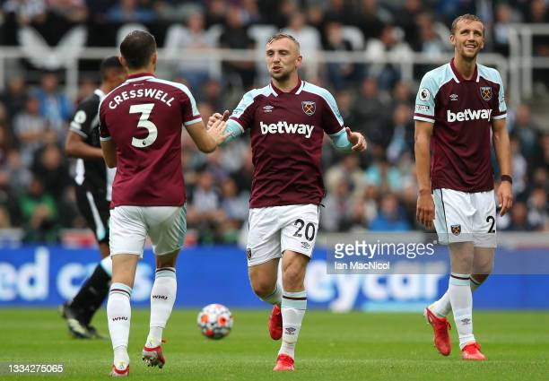 Aaron Cresswell, Jarrod Bowen and Tomas Soucek of West Ham United celebrate their side's first goal during the Premier League match between Newcastle...