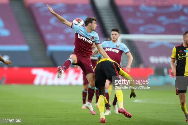 Aaron Cresswell of West Ham battles with Ismaila Sarr of Watford during the Premier League match between West Ham United and Watford FC at London...