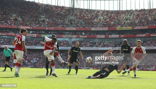 Aaron Cresswell of West Ham blocks a shot from Alexandre Lacazette of Arsenal during the Premier League match between Arsenal and West Ham United at...