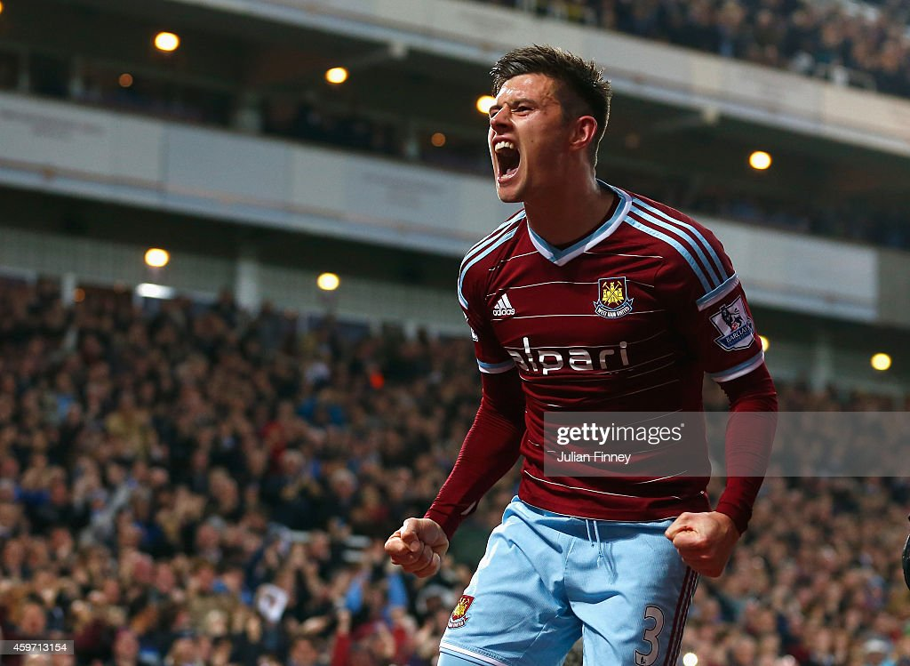 Aaron Cresswell of West Ham celebrates scoring opening goal during the Barclays Premier League match between West Ham United and Newcastle United at Boleyn Ground on November 29, 2014 in London, England.