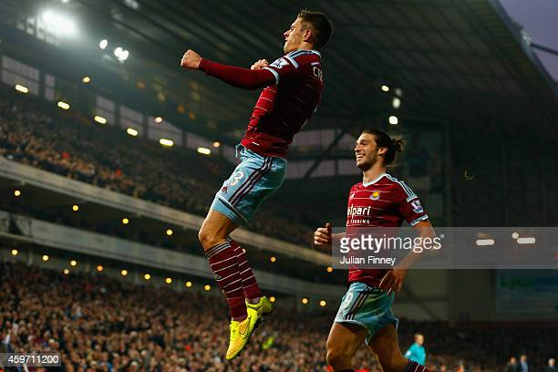 Aaron Cresswell of West Ham celebrates scoring opening goal with Andy Carroll of West Ham during the Barclays Premier League match between West Ham...