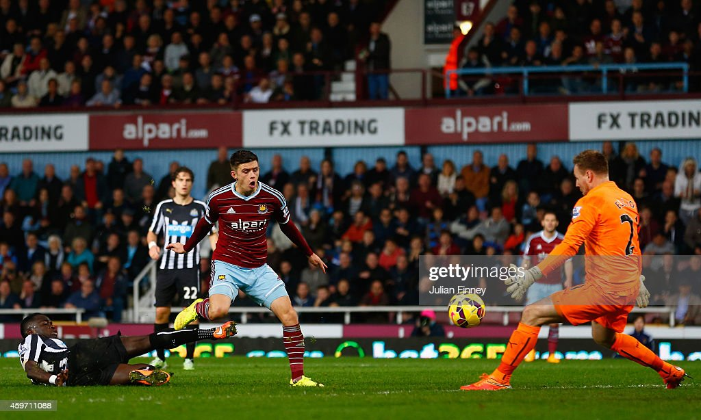 Aaron Cresswell of West Ham scores the opening goal past Robert Elliot of Newcastle United during the Barclays Premier League match between West Ham United and Newcastle United at Boleyn Ground on November 29, 2014 in London, England.