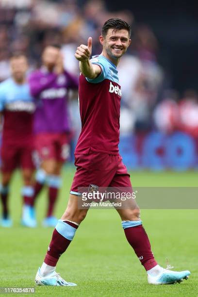 Aaron Cresswell of West Ham United acknowledges the fans his sides victory the Premier League match between West Ham United and Manchester United at...