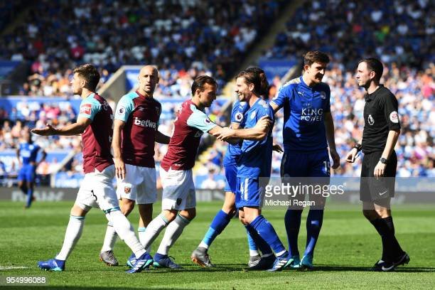 Aaron Cresswell of West Ham United and Adrien Silva of Leicester City clash during the Premier League match between Leicester City and West Ham...