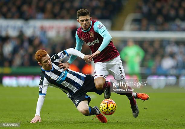 Aaron Cresswell of West Ham United and Jack Colback of Newcastle United compete for the ball during the Barclays Premier League match between...