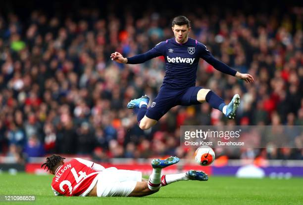 Aaron Cresswell of West Ham United and Reiss Nelson of Arsenal in action during the Premier League match between Arsenal FC and West Ham United at...