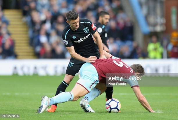 Aaron Cresswell of West Ham United battles with James Tarkowski of Burnley during the Premier League match between Burnley and West Ham United at...