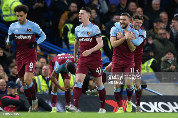 Aaron Cresswell of West Ham United celebrates scoring his side's first goal with team mate Robert Snodgrass during the Premier League match between...