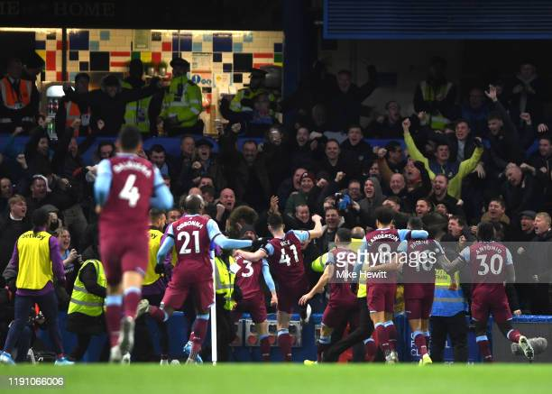 Aaron Cresswell of West Ham United celebrates with teammates after scoring his team's first goal during the Premier League match between Chelsea FC...