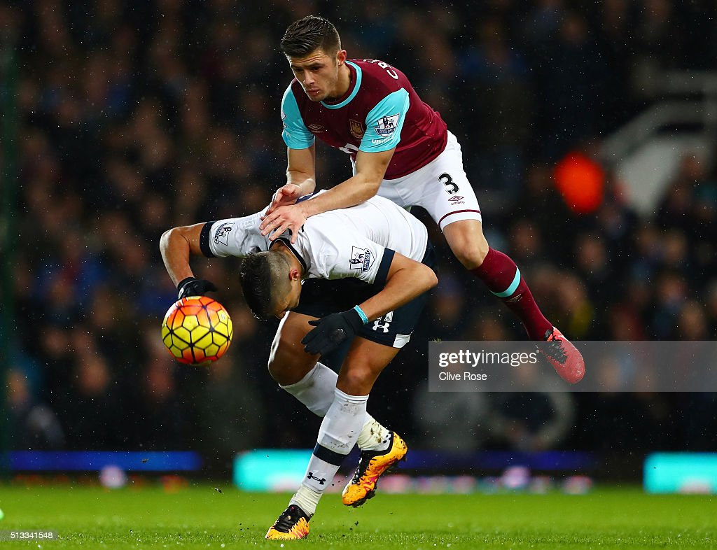 Aaron Cresswell of West Ham United challenges Erik Lamela of Tottenham Hotspur for the ball during the Barclays Premier League match between West Ham United and Tottenham Hotspur at Boleyn Ground on March 2, 2016 in London, England.