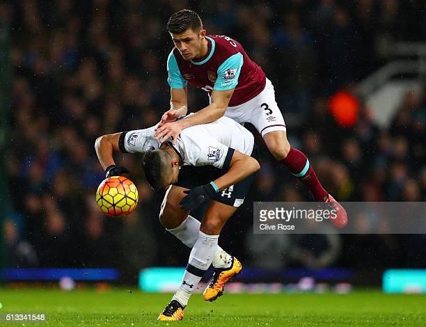 Aaron Cresswell of West Ham United challenges Erik Lamela of Tottenham Hotspur for the ball during the Barclays Premier League match between West Ham...