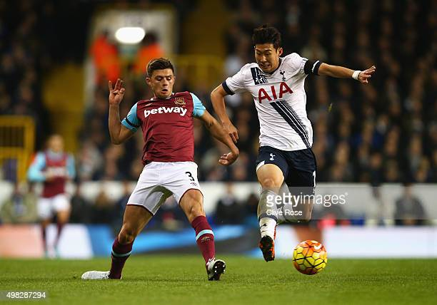 Aaron Cresswell of West Ham United challenges HeungMin Son of Tottenham Hotspur during the Barclays Premier League match between Tottenham Hotspur...