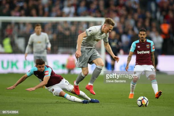 Aaron Cresswell of West Ham United gets tackled by Scott McTominay of Manchester United during the Premier League match between West Ham United and...