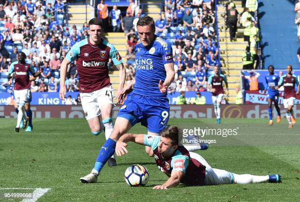 Aaron Cresswell of West Ham United handles the ball at the feet of Jamie Vardy of Leicester City during the Premier League match between Leicester...