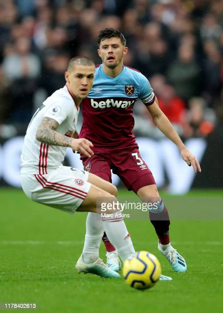 Aaron Cresswell of West Ham United in action with Muhamed Besic of Sheffield United during the Premier League match between West Ham United and...