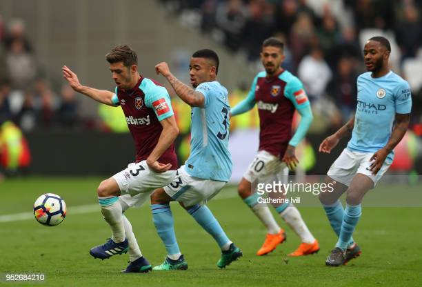 Aaron Cresswell of West Ham United is challenged by Gabriel Jesus of Manchester City during the Premier League match between West Ham United and...