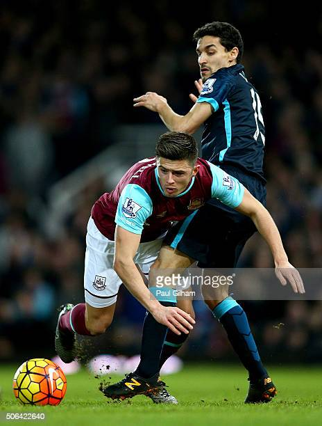 Aaron Cresswell of West Ham United is challenged by Jesus Navas of Manchester City during the Barclays Premier League match between West Ham United...