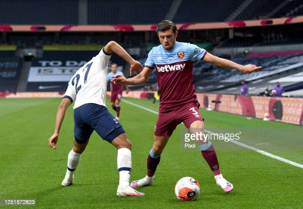Aaron Cresswell of West Ham United is challenged by Lucas Moura of Tottenham Hotspur during the Premier League match between Tottenham Hotspur and...