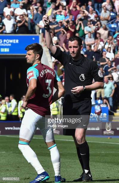Aaron Cresswell of West Ham United is shown a yellow card by referee Christopher Kavanagh for a handball during the Premier League match between...